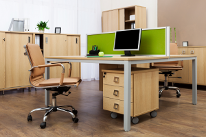 Wood chairs,cabinet and table with a computer monitor on top with a green background
